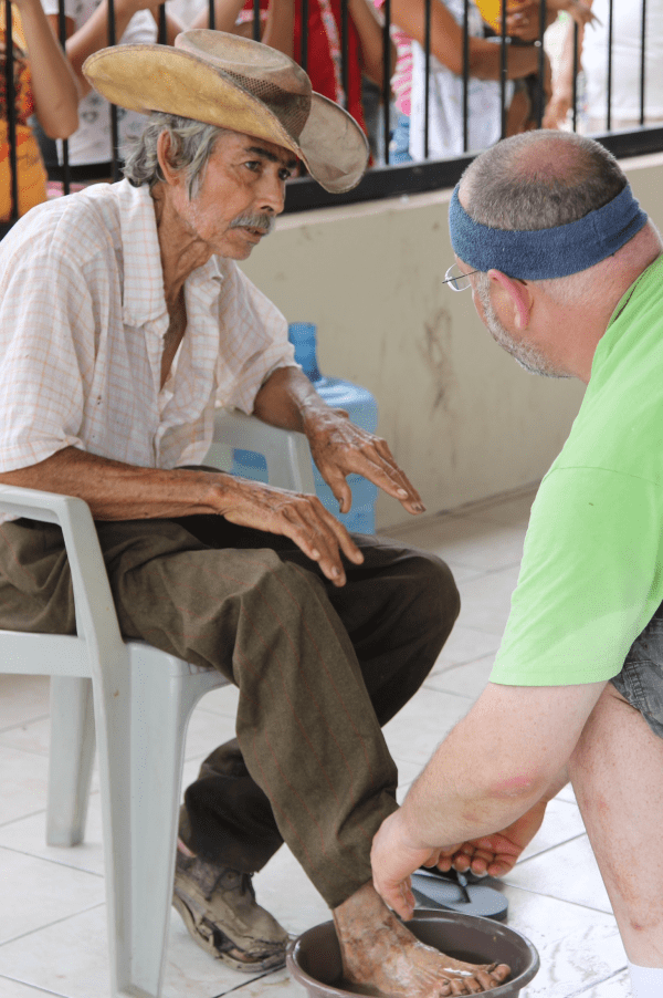 BH washing feet of Guatemalan man